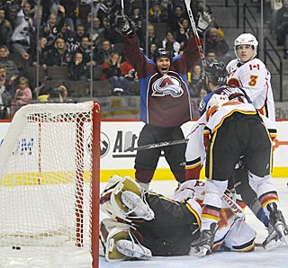 Colorado celebrates its third goal after the puck eludes Calgary goalie Miikka Kiprusoff.  (US Presswire)
