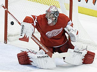 Detroit's Jimmy Howard makes one of his 30 saves en route to earning his 10th victory of the season.  (AP)