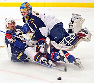 Rangers captain Chris Drury gets caught between Atlanta's Ron Hainsey (left) and Johan Hedburg.  (AP)