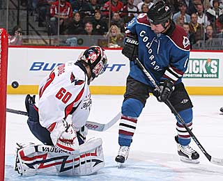 Jose Theodore deflects a shot and holds Colorado to just one goal. (Getty Images)