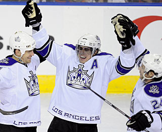 What are Sean O'Donnell (left) and the Kings celebrating? Taking over the top spot in the West.  (AP)