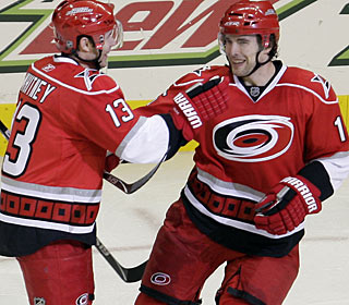 Tuomo Ruutu (right) scores three goals in a game for the first time in 353 games in the NHL. (AP)