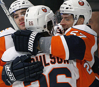 John Tavares and Matt Moulson celebrate with game-winning goal scorer Blake Comeau (right). (AP)