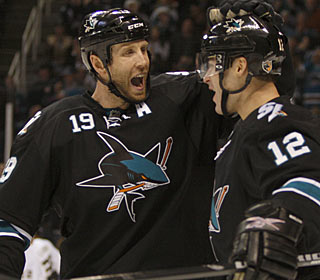 Talk about productive: Joe Thornton and Patrick Marleau combine for three goals and four assists. (AP)