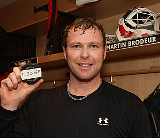 Martin Brodeur stops 27 shots in setting the record for the most games played by a goalie. (Getty Images)