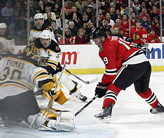 Jonathan Toews puts the puck past Tim Thomas for his 10th goal. He also scores in the SO. (Getty Images)