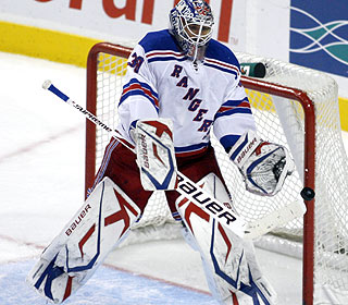 Henrik Lundqvist, who stops 36 shots, gets the lead in the second and makes sure it holds up. (AP)