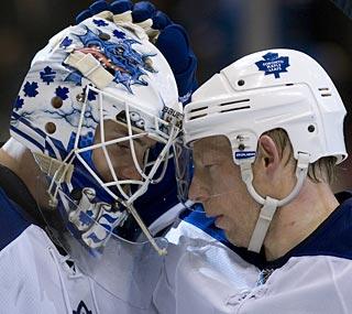 Toronto goalie Jonas Gustavsson celebrates his first career shutout with teammate Jason Blake.  (AP)