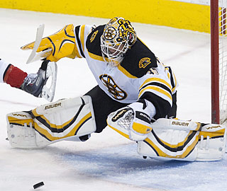 Tim Thomas keeps his eyes on the puck en route to his fourth shutout of the season.  (AP)