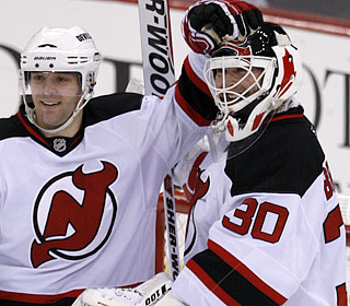 Martin Brodeur receives props after passing Terry Sawchuk as the all-time shutout leader.  (AP)