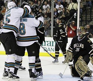 Dany Heatley and Joe Pavelski celebrate a Sharks goal in front of Stars goaltender Marty Turco.  (AP)