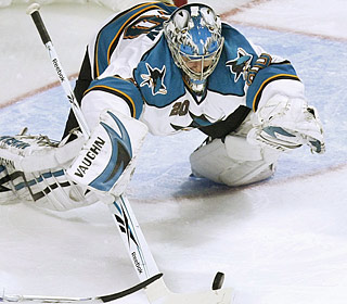 Evgeni Nabokov prepares to pounce on the puck as the Sharks goalie finishes with 45 saves in the win.  (AP)