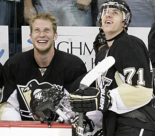 Jordan Staal is all smiles after Evgeni Malkin, also happy, completes his fourth career hat trick. (AP)