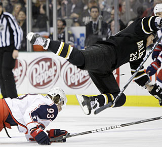 Stars center Steve Ott (29) goes flying after a collision with Jakub Voracek. (AP)