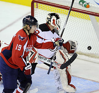 Nicklas Backstrom puts this backhander past Martin Brodeur for his 15th goal this season. (AP)