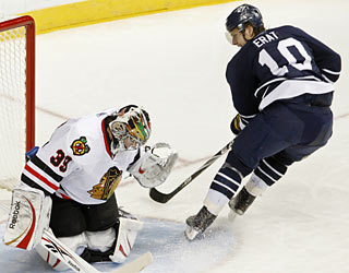 The Predators' Martin Erat is unable to send a shot past goalie Cristobal Huet, who makes 25 saves. (AP)