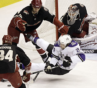 Coyotes defenders make sure goalie Ilya Bryzgalov has plenty of protection around the net. (AP)