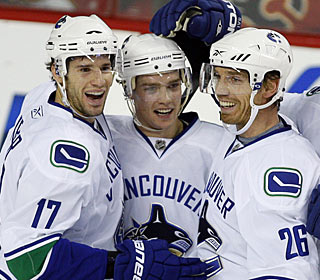Mason Raymond (center) gets his first career three-goal game in his third season in the NHL. (AP)