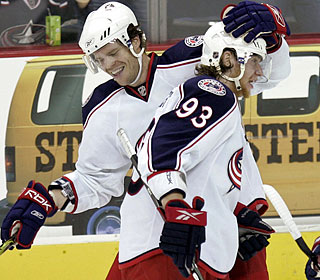 Fredrik Modin scores the winner and celebrates with Jakub Voracek (93) as the Jackets end their skid.  (AP)