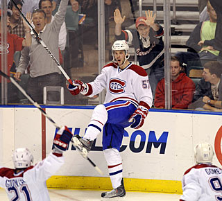 At the time of scoring, Benoit Pouliot did not know his goal would turn out to be the winning goal. (AP)
