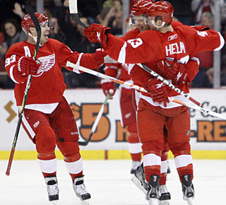 Kris Draper and Brad Stuart congratulate Darren Helm, who scores his first of two short-handed goals. (AP)