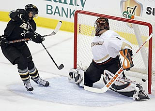 Loui Eriksson completes his hat trick by tipping in a shot past Jonas Hiller in the second period.  (AP)
