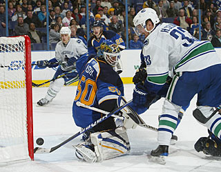 Henrik Sedin bangs in the tying goal with an assist from his brother Daniel. (Getty Images)