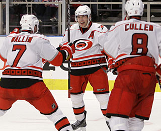 Ray Whitney's goal in overtime gives the Hurricanes a split of their home-and-home with the Rangers. (AP)