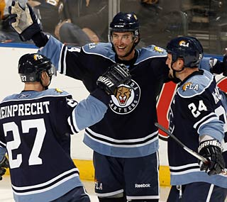 The Panthers' Radek Dvorak (middle) celebrates the third hat trick of his career.  (Getty Images)