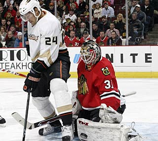 Antti Niemi shuts down the Ducks, but he loses his shutout bid late in the third period.  (Getty Images)