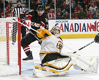 Tim Thomas beats the Sens an 11th consecutive time and is 4-0 against them this season.  (Getty Images)