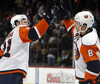 Kyle Okposo gets kudos from Bruno Gervais after scoring the go-ahead goal late in the third. (AP)