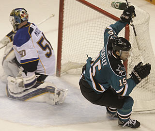 Dany Heatley just buries the puck past Chris Mason for the winner and his 25th goal. (AP)