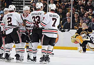The Blackhawks gather together to celebrate after scoring one of their five straight goals. (Getty Images)