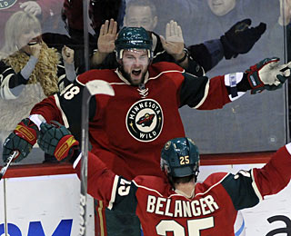 Guillaume Latendresse celebrates the tying goal with 93 seconds left in regulation. (AP)