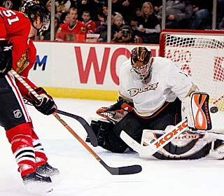 'He came up huge for us,' Corey Perry says of Jonas Hiller, who denies 42 shots.  (Getty Images)
