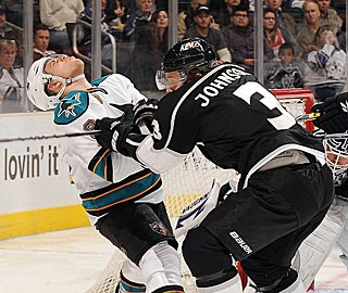 Joe Pavelski takes a shot from L.A.'s Jack Johnson, but San Jose takes the decision.  (Getty Images)