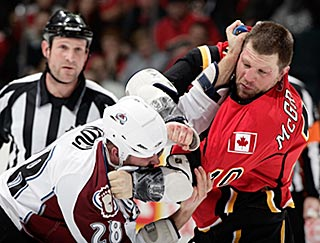Colorado's David Koci (28) squares off with Calgary's Brian McGrattan in the first period.  (Getty Images)