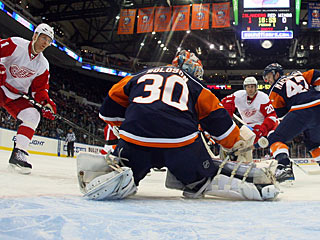 Dwayne Roloson makes one of just two saves he needs to make in the second period. (Getty Images)