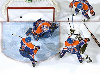 A weird way to win: The puck banks off Pascal Dupuis' skate past a stickless Devan Dubnyk.  (Getty Images)