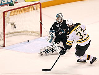 Boston's Zdeno Chara beats San Jose's Evgeni Nabokov for the only goal in the shootout.  (Getty Images)