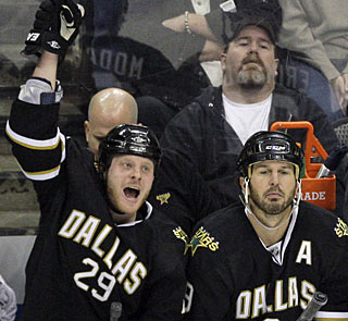 Steve Ott pumps his fist after a video review rules his shootout goal counts as the winner. (AP)