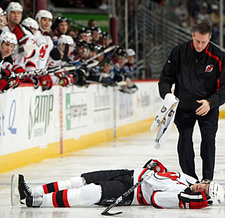 Patrik Elias lays motionless for a few minutes after taking a hit from Ryan Wilson. (Getty Images)