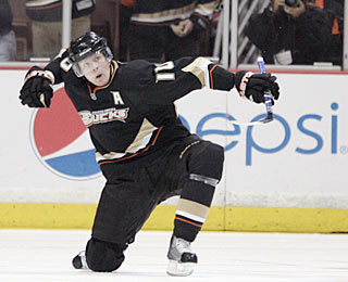 Corey Perry celebrates his 19th goal, which ties the score in the third period.  (AP)