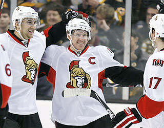 Ottawa is happy to have Daniel Alfredsson (center) back. The captain enjoys one of his three goals.  (AP)