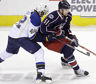 Rick Nash is a step ahead of the Blues, scoring the go-ahead goal for his 400th career point.  (AP)