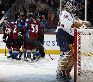 It's not Jeff Deslauriers' night as he gives up six Colorado goals in the defeat.  (AP)