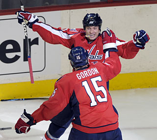 The Capitals' Matt Bradley celebrates his goal in the second period with teammate Boyd Gordon.  (AP)