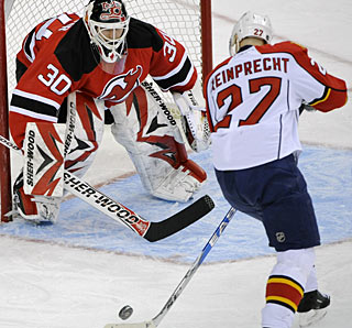 Martin Brodeur stops 22 shots for his fifth shutout in 14 games and seventh this season. (AP)