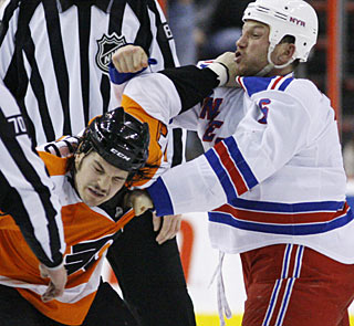 Hatred between Rangers vs. Flyers? Sean Avery and Dan Carcillo is one of four fights in the game. (AP)